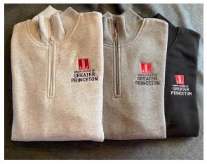 three JLGP-branded sweatshirts